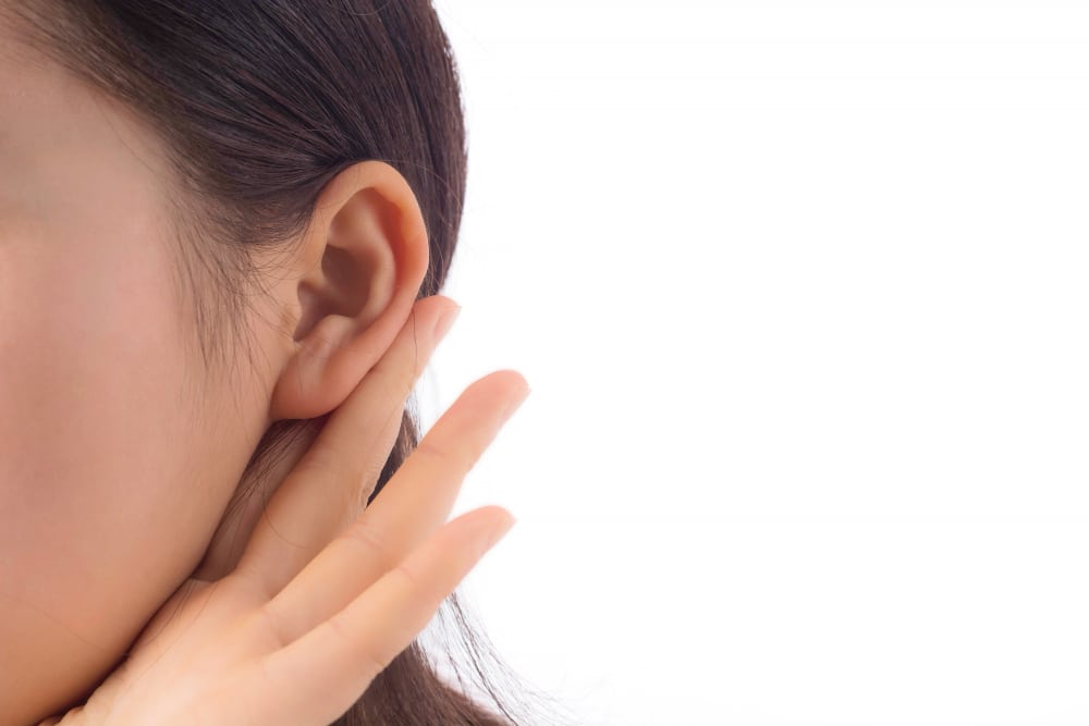 cosmetic surgical otoplasty to pin ears back when having protruding ears